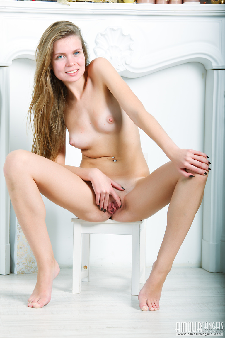 young girl spreads in side her nude legs and small pink pussy opened